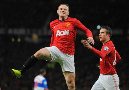 Manchester United's forward Wayne Rooney (L) celebrates after scoring at Old Trafford in Manchester, March 16, 2013