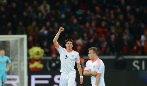 Bayern Munich's striker Mario Gomez celebrates after scoring in Leverkusen, western Germany, on March 16, 2013