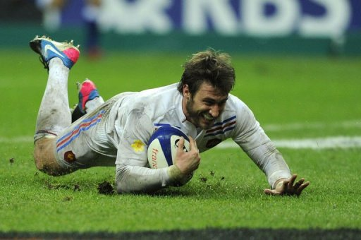 France's left wing Maxime Medard scores a try at the Stade de France, in Saint-Denis, near Paris on March 16, 2013