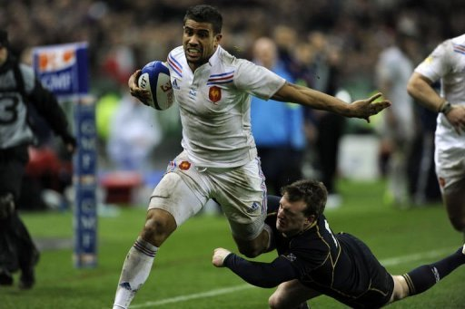 France's centre Wesley Fofana runs to score a try at the Stade de France, in Saint-Denis, near Paris on March 16, 2013