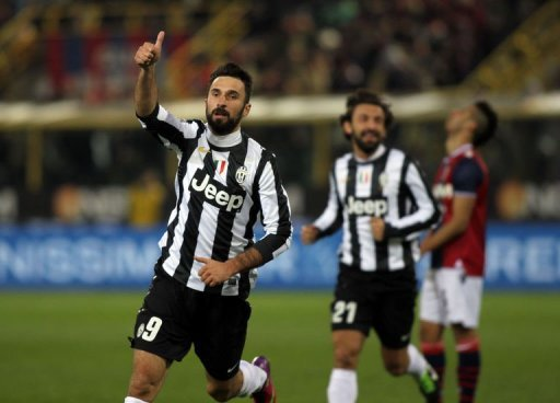 Mirko Vucinic (L) celebrates scoring during their Italian Serie A match against Bologna on March 16, 2013 in Bologna