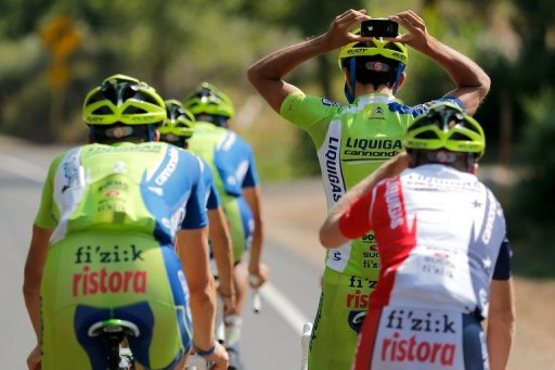 Moreno Moser of Italy takes a photo behind his head of a teammate on August 19, 2012 in Durango, Colorado