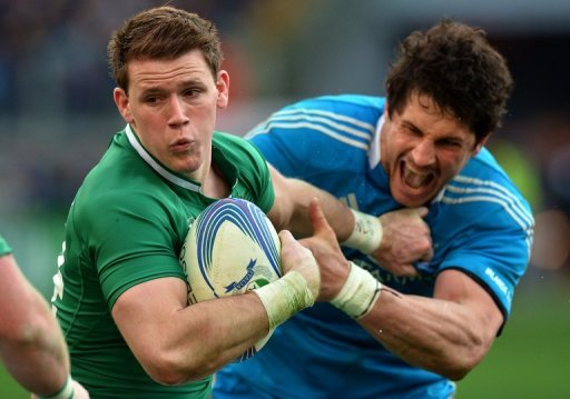 Ireland's Iain Henderson (L) is tackled by Italy's Alessandro Zanni during their Six Nations match on March 16, 2013