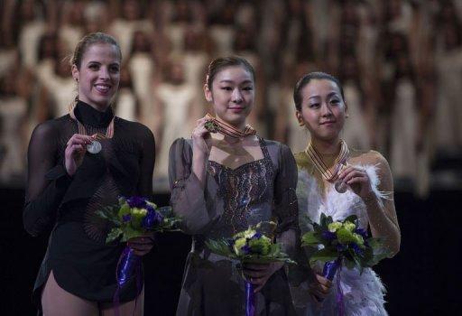 Carolina Kostner (L), Kim Yu-na (C) and Mao Asada at the World Figure Skating Championships on March 16, 2013