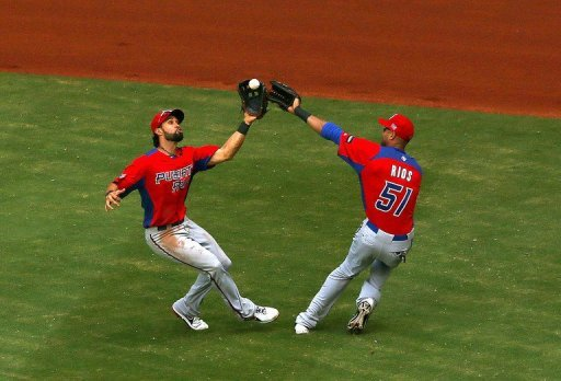 Angel Pagan (L) and Alex Rios of Puerto Rico during their WBC game against Dominican Republic on March 16, 2013
