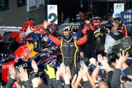 Kimi Raikkonen celebrates winning the season-opening Australian Formula One GP, in Melbourne, on March 17, 2013