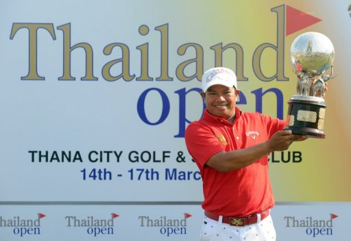 Prayad Marksaeng poses with the winner's trophy after the final round of the Thailand Open in Bangkok on March 17, 2013
