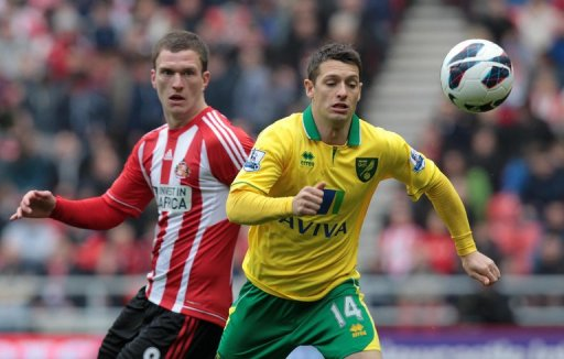 Craig Gardner (left) is tackled by Wes Hoolahan during their Premier League match in Sunderland on March 17, 2013