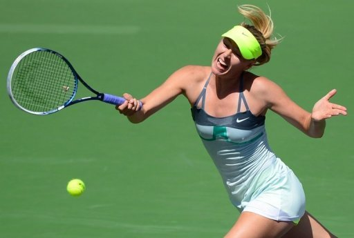 Maria Sharapova of Russia hits a return to Caroline Wozniacki of Denmark on March 17, 2013 in Indian Wells