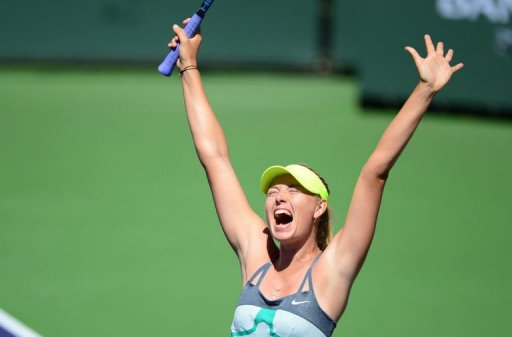 Maria Sharapova celebrates her 6-2, 6-2 victory over Caroline Wozniacki on March 17, 2013