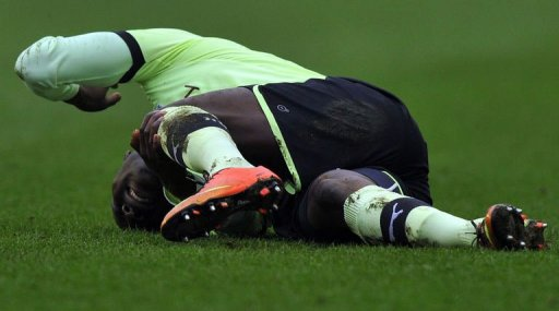 Newcastle United's Massadio Haidara is injured after a tackle at The DW Stadium in Wigan on March 17, 2013