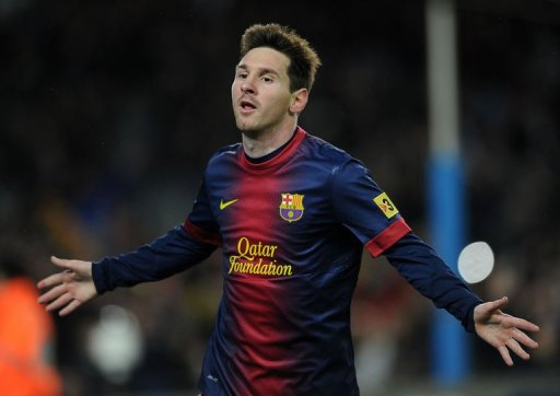 Barcelona's Lionel Messi celebrates after scoring at the Camp Nou stadium in Barcelona on March 17, 2013
