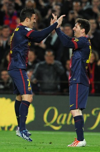 Barcelona's Lionel Messi (R) celebrates with David Villa after scoring in Barcelona on March 17, 2013