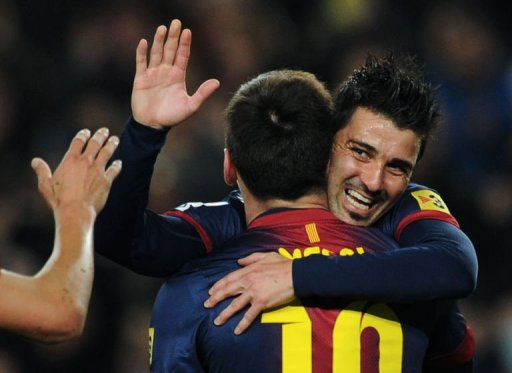 Barcelona's David Villa (R) celebrates with Lionel Messi after scoring in Barcelona on March 17, 2013