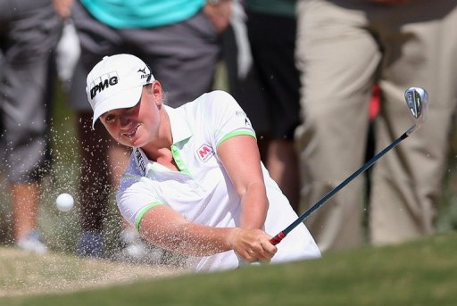 Stacy Lewis chips from the bunker onto the fifth hole green on March 17, 2013 in Phoenix, Arizona