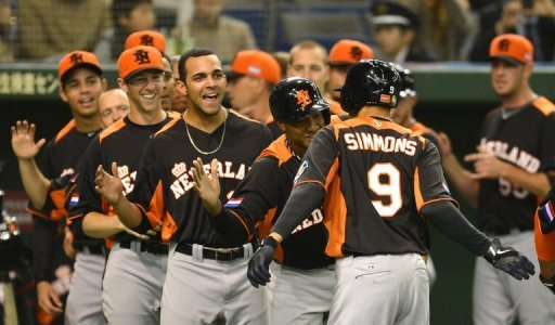 Dutch infielder Andrelton Simmons (no. 9) is congratulated by his teammates during their WBC game on March 12, 2013