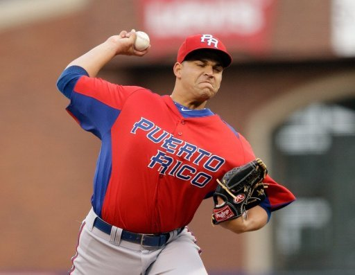 Mario Santiago of Puerto Rico pitches during their WBC semi-final against Japan on March 17, 2013