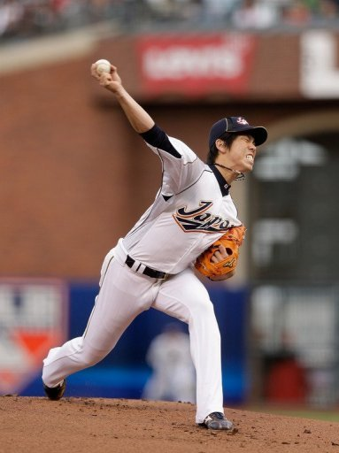 Kenta Maeda of Japan pithes during their WBC semi-final against Puerto Rico on March 17, 2013