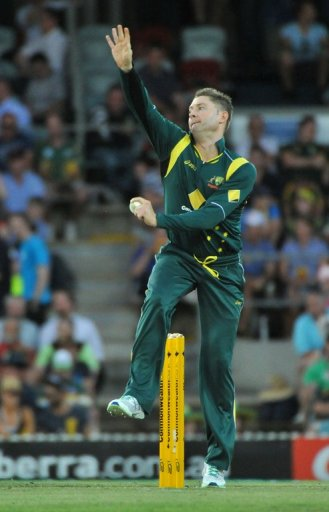 Michael Clarke bowls during a one-day International cricket match in Canberra on February 6, 2013