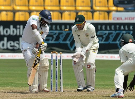 Sri Lanka's Rangana Herath (L) is dismissed during the third day of the second Test against Bangladesh on March 18, 2013