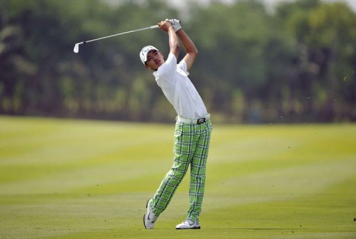Guan Tianlang hits a shot at the Amata Spring Country Club in Chonburi, on November 3, 2012