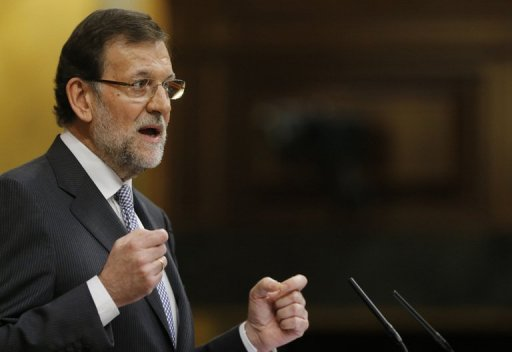 Spain's Prime Minister Mariano Rajoy delivers a speech during a parliamentary debate in Madrid, on February 20, 2013