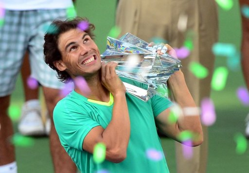 Rafael Nadal holds the championship trophy on March 17, 2013 in Indian Wells