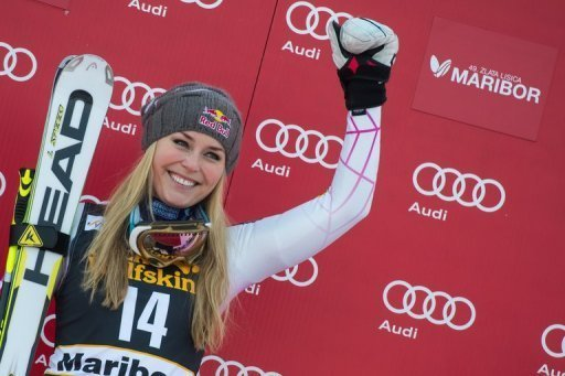 Lindsey Vonn celebrates winning the FIS World Cup giant slalom in Slovenia on January 26, 2013