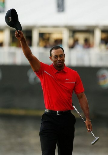 Tiger Woods celebrates victory in Doral, Florida on March 10, 2013