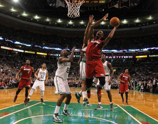 Chris Bosh of the Miami Heat beats Jeff Green of the Boston Celtics to the basket in the first half on March 18, 2013