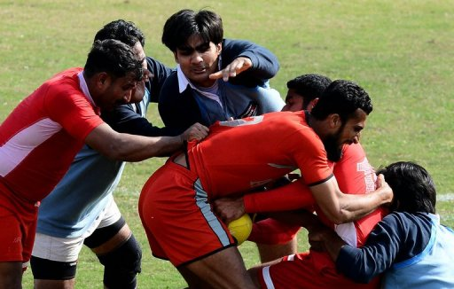 Local Pakistani rugby players fight for the ball during a match between the Army and the Lahore team, February 24, 2013