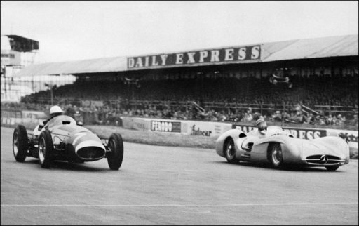 Picture taken in 1954 at Silverstone shows Juan Manuel Fangio (R) in a Mercedes competing with Stirling Moss