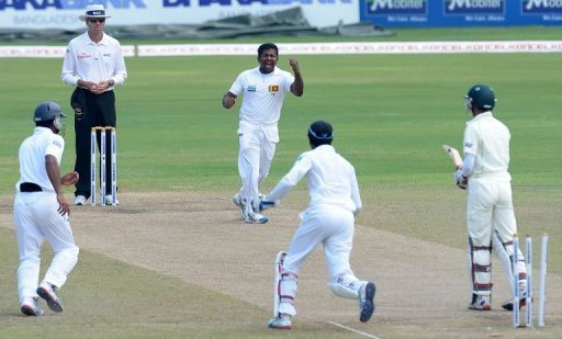 Rangana Herath celebrates the dismissal of Nasir Hossain during the fourth day in Colombo on March 19, 2013