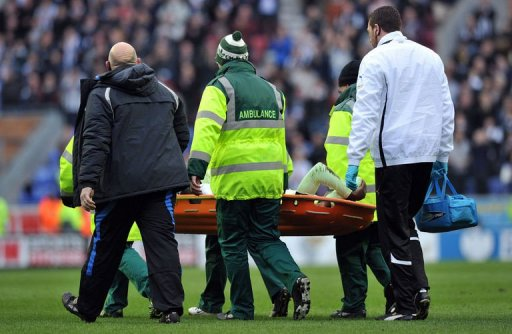 Newcastle United's Massadio Haidara is stretchered off the pitch in Wigan, on March 17, 2013