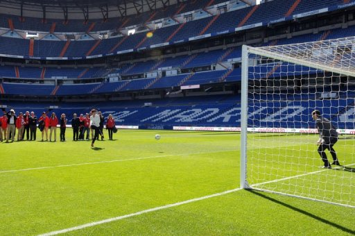 Members of the IOC evaluation team try to score past Real Madrid's goalkeeper Iker Casillas in Madrid on March 18, 2013