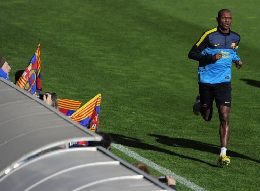 Eric Abidal takes part in an open training session at the Mini Stadium in Barcelona on January 4, 2013