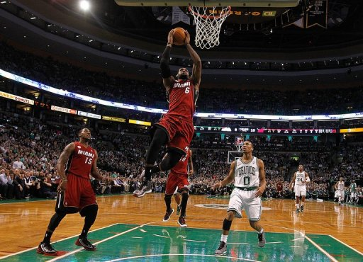 LeBron James of the Miami Heat scores by Avery Bradley of the Boston Celtics in the first quarter on March 18, 2013