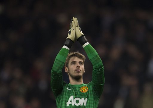 David de Gea applauds supporters at the Santiago Bernabeu stadium in Madrid on February 13, 2013