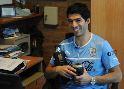 Luis Suarez smiles during an interview with AFP after a training session on March 19, 2013, in Montevideo