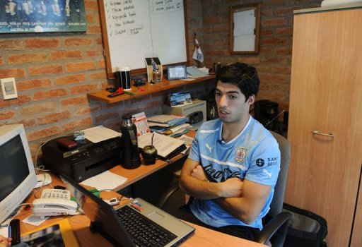 Luis Suarez speaks during an interview with AFP, after a training session on March 19, 2013, in Montevideo