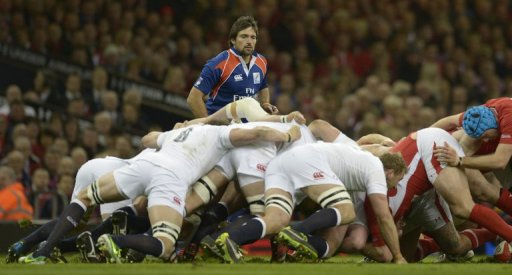 Australian referee Steve Walsh officiates as the scrum collapses on March 16, 2013