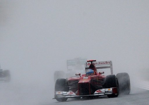 Ferrari driver Fernando Alonso battled the elements to win the Malaysian Grand Prix on March 25, 2012