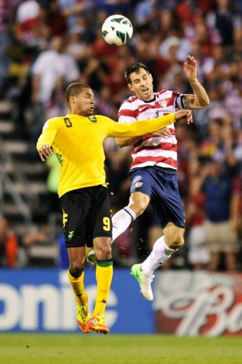 Carlos Bocanegra (R) goes up for the ball with Ryan Johnson of Jamaica on September 11, 2012