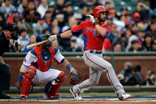 Angel Pagan of Puerto Rico hits a single at the 2013 World Baseball Classic on March 19, 2013 in San Francisco.