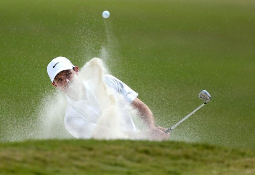 Charl Schwartzel plays a bunker shot at the WGC-Cadillac Championship on March 10, 2013