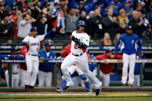 Robinson Cano of the Dominican Republic scores on a two-run RBI double hit by Edwin Encarnacion on March 19, 2013