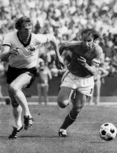 Yugoslavia's Dragan Dzajic (R) chases West Germany's Hans-Georg Schwarzenberg during a 1974 World Cup match