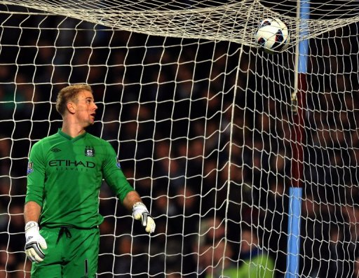 Manchester City's Joe Hart eyes the ball at Villa Park in Birmingham on March 4, 2013