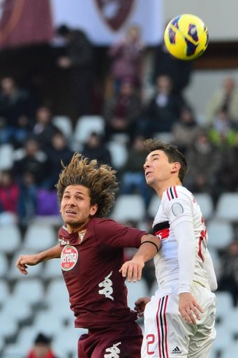 AC Milan defender Mattia De Sciglio (R) goes up for the ball with Torino midfielder Alessio Cerci on December 9, 2012