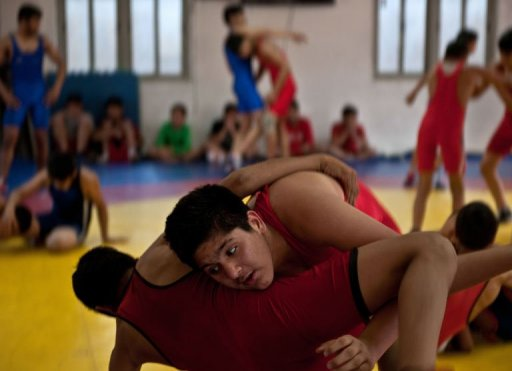 Young Indian wrestlers train in New Delhi on March 4, 2013